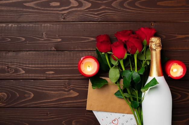Bouquet of roses and champagne top view