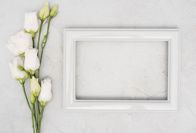 Bouquet of roses and empty vintage frame