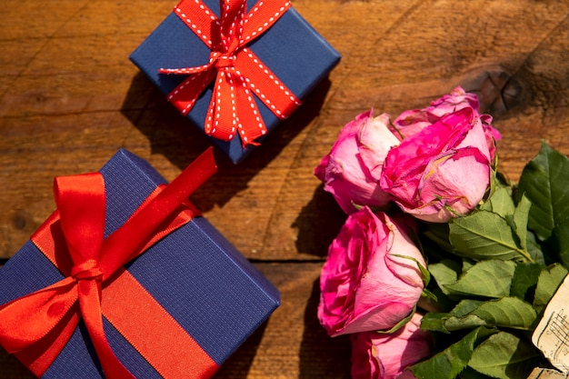 Bouquet of roses and gifts