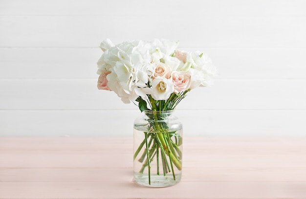 Bouquet of roses and hydrangeas on table
