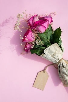 Bouquet of roses wrapped in music sheet