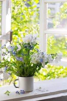 Bouquet of spring flowers on windowsill