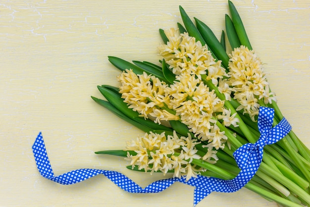 Bouquet of spring hyacinths decorated with ribbon. top view, copy space