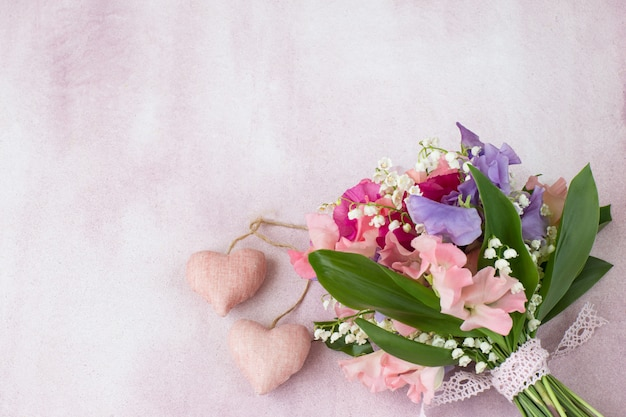A bouquet of sweet peas and lilies of the valley
