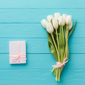 Bouquet of tulip flowers and gift
