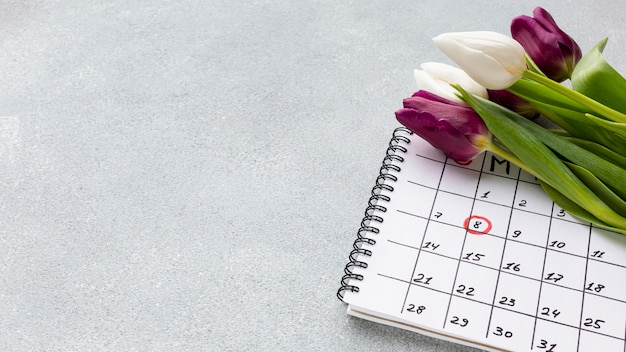 Bouquet of tulips on calendar with copy space