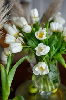 Bouquet of tulips close-up, buds and leaves