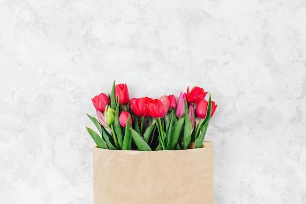 Bouquet of tulips  in paper kraft paper bag