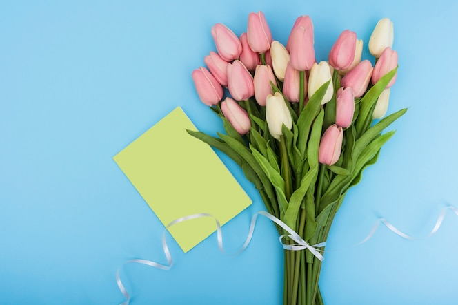 Bouquet of tulips with green card