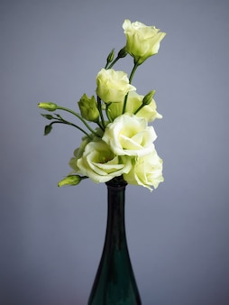 Bouquet of white eustoma flowers in vase