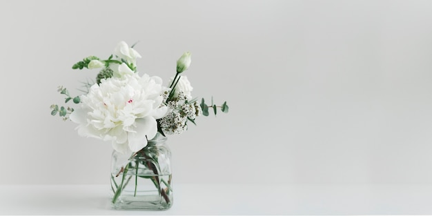 Bouquet of white flowers in a cleared vase