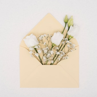 Bouquet of white roses in an envelope