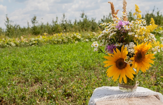 A bouquet of wild flowers in a field on nature. cottage life, summer concept