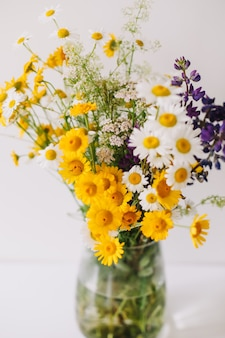 Bouquet of wild natural flowers in a vase
