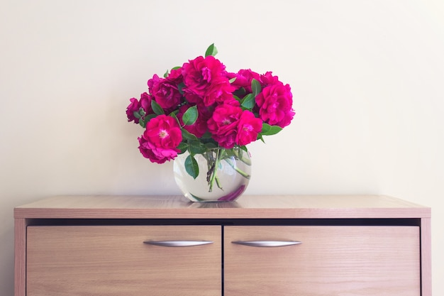 Bouquet of wild tea roses in ball glass