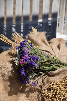 Bouquet of wildflowers and herbs on burlap on the day of the summer solstice space for text