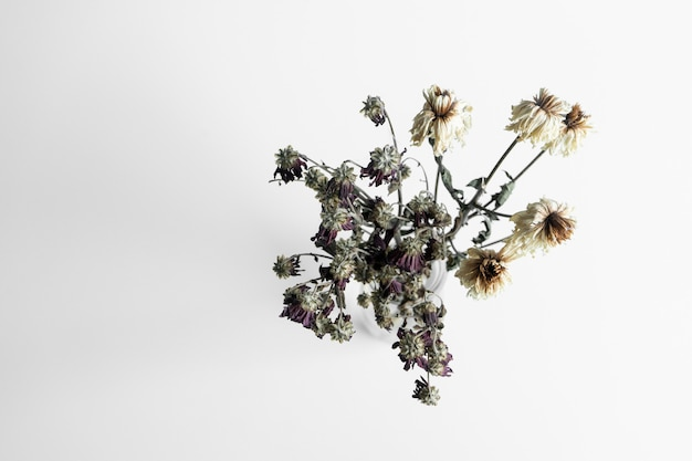 Bouquet of wilted flowers on white