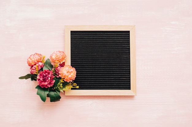 Bouquet with blackboard on vintage background