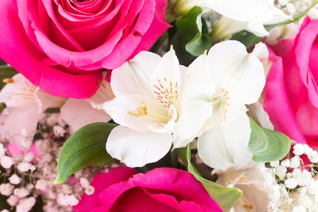 Bouquet with bright flowers . a background of floral roses. beautiful flowers. a gift for the holiday.