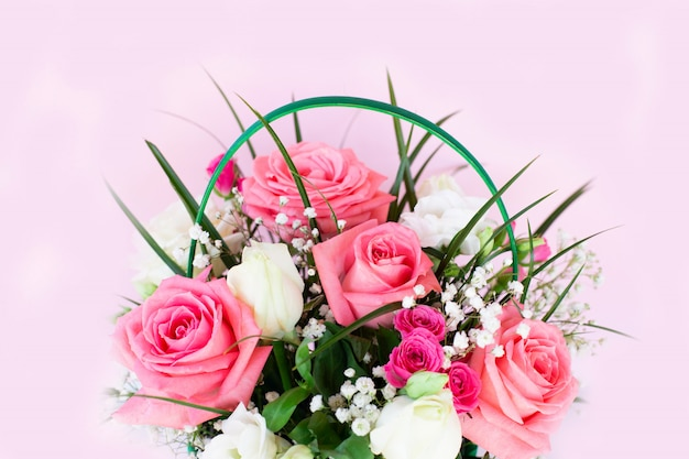 Bouquet with pink and white roses on pink background