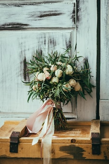 Bouquet on a wooden old box
