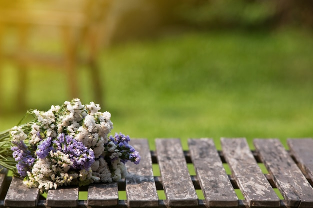 Bouquet on a wooden table with green grass