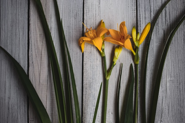 Bouquet of yellow lilies on a wooden background, wedding bouquet