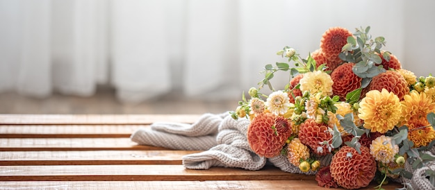 A bouquet of yellow and orange chrysanthemums on a blurred background.
