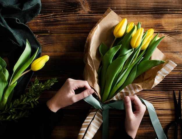 Bouquet of yellow tulips on table
