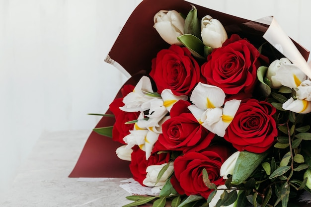 Bouquets of different flowers red roses and white.