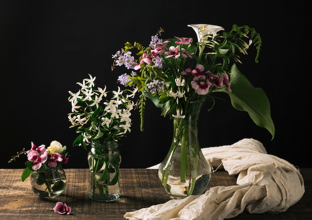 Bouquetsof flowers in vases on table