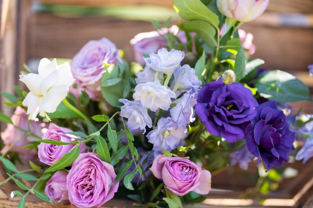 Bouquets of fresh flowers decoration of the festive table. celebrating an open air party. decor details