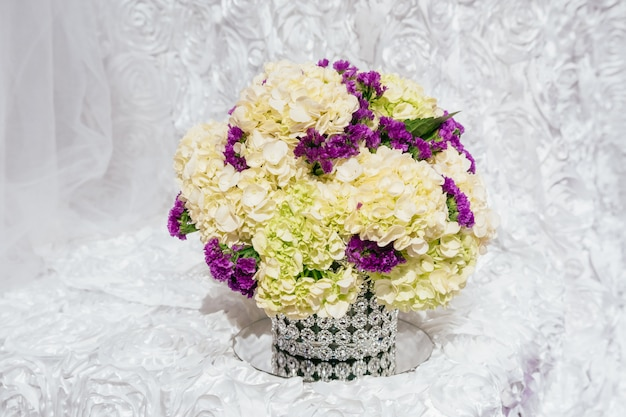 Bouquets of roses on a festive wedding table in the restaurant wedding flowers and a table