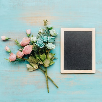 Bouquets with blackboard on the right.