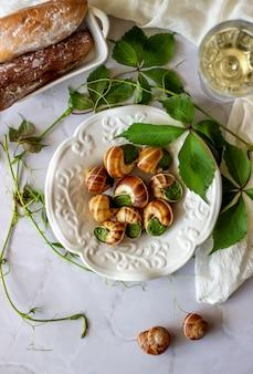 Bourguignonne snail with lemon marble surface french cuisine