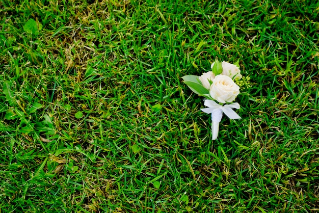 Boutonniere on a green grass.