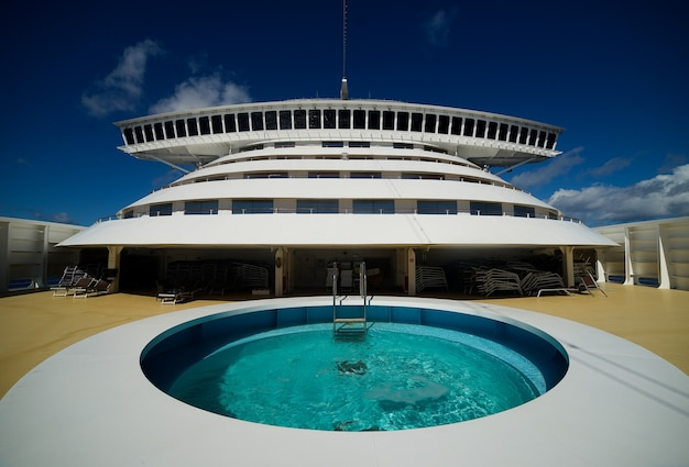 The bow of cruise ship with pool and captain's bridge.