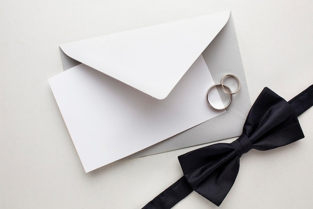 Bow tie and envelopes save the date wedding concept