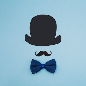 Bow tie near ornamental mustache and top hat
