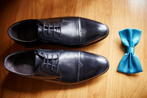 Bow tie and shoes of the groom