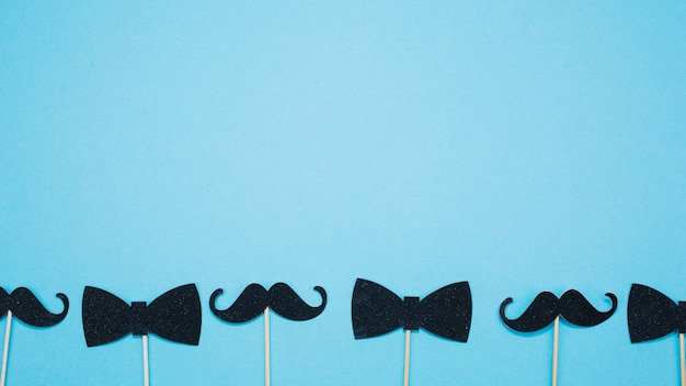 Bow ties and mustaches on wands