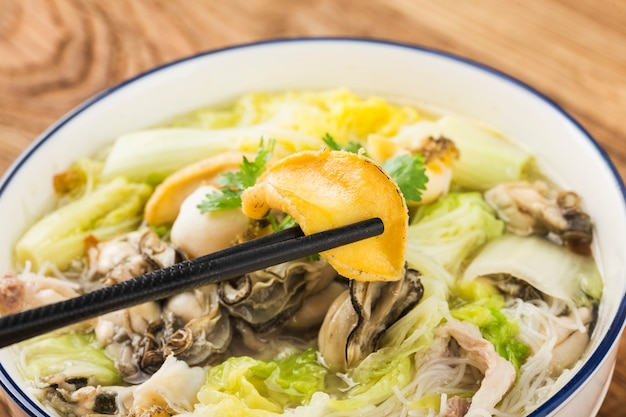 A bowl of abalone oyster rice noodles