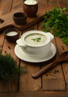 Bowl of azerbaijani dovga yoghurt soup with herbs