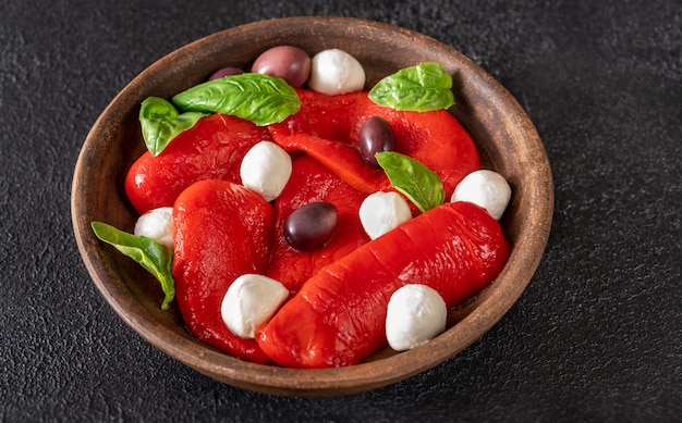 Bowl of baked bell peppers with mozarella and kalamata olives