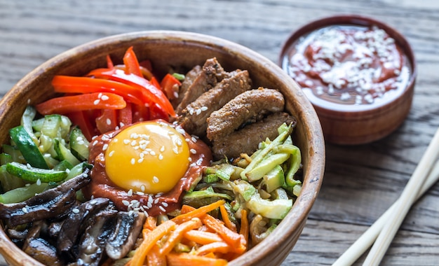 Bowl of bibimbap on the wooden table