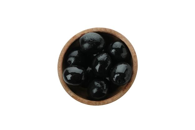 Bowl of black olives isolated on white background