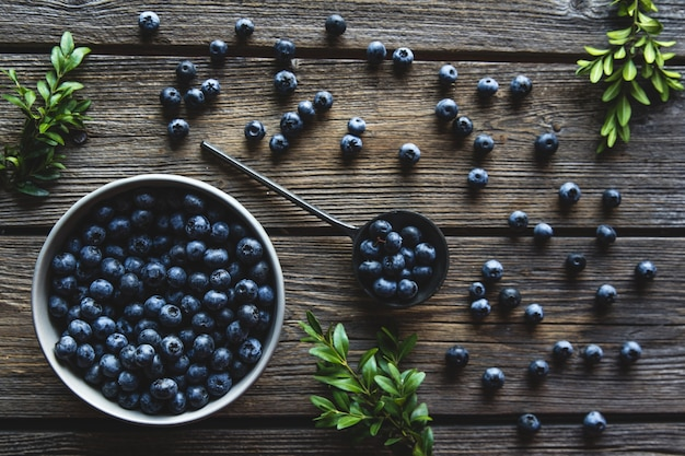 Bowl of blueberries on a wooden background. healthy food, health