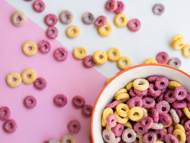 Bowl of cereal in a corner surrounded by fruit loops