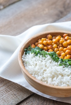 Bowl of chickpea curry with white rice and fresh cilantro