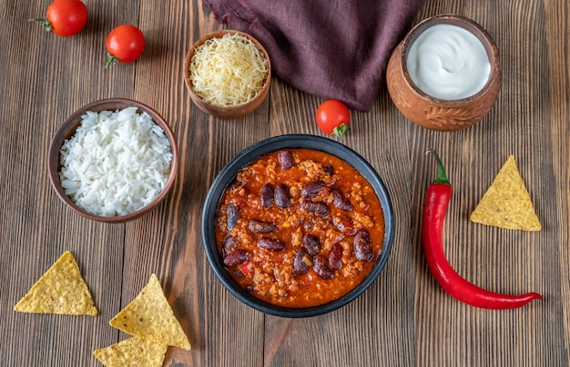 Bowl of chili with meat with ingredients